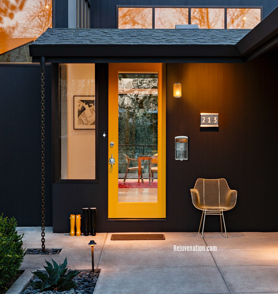 modern entry by rejuvenation. inviting wire chair, rain chain and yellow door
