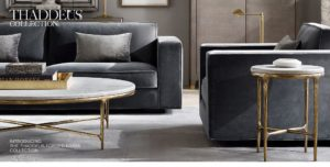 Gray sofa and chair with gold and white accent tables