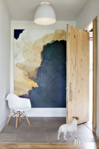 Blue oversized art with white chair